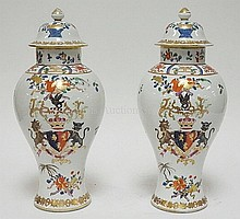 PAIR OF ARMORIAL COVERED URNS; HAND PAINTED