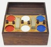 INLAID ROSEWOOD POKER BOX W/CHIPS AND CARD DECKS. BIRDSEYE MAPLE INTERIOR SURFACE. WOODEN LEVERS LIFT THE CHIPS. 7 1/2 IN X 4 1/4 IN, 4 1/4 IN H. FINISH WEAR ON THE TOP.