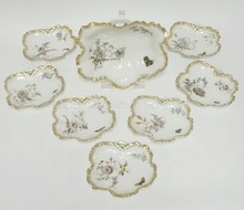 HAVILAND AND CO. LIMOGES 8 PIECE ICE CREAM SET. HAND PAINTED W/ FLOWERS AND BUTTERFLIES. FOR DAVIS COLLAMORE AND CO. BROADWAY AND 21ST ST, NEW YORK. MASTER BOWL IS 11 1/4 IN X 9 1/2 IN.