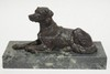 BRONZE DOG MOUNTED ON A GREEN MARBLE BASE. BASE IS 12 1/4 IN X 4 7/8 IN. 6 3/4 IN TOTAL HEIGHT.