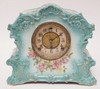 CHINA CASE CLOCK. HAS A FLAT FLAKE ON THE BACK SIDE EDGE. 12 1/2 IN WIDE, 11 IN H. NO. 435 ON THE BACK.