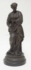 METAL FIGURE OF A WOMAN HOLDING PALETTE AND BRUSHES. 21 1/2 IN H.