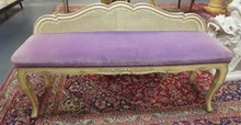 CARVED AND PAINT DECORATED DOUBLE CANE BACK BENCH.  50 IN WIDE