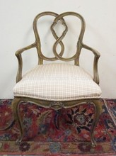 CARVED, PAINT DECORATED ARM CHAIR W/ UPHOLSTERED SEAT.