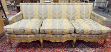CARVED, PAINT DECORATED SOFA W/ BLUE AND GOLD BROCADE UPHOLSTERY. 75 1/2 IN WIDE.