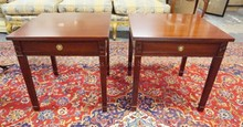 PAIR OF CARVED MAHOGANY ONE DRW LAMP TABLES.