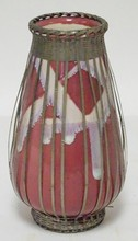 ART POTTERY VASE- PINK W/ WHITE DRIP GLAZE DECORATION. IN A BASKETWEAVE METAL CAGE. 7 1/4 IN H