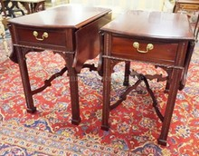 PAIR OF CARVED MAHOGANY ONE DRW DROP LEAF END TABLES. HAVE  FAUX DRAWER IN THE BACK