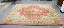 ROOM SIZE ORIENTAL RUG WITH A SALMON PINK CENTER MEDALLION AND BEIGE BORDER. 9 FT 9 IN X 7 FT 9 IN