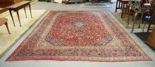 ROOM SIZE RED ORIENTAL RUG. 12 FT  8 IN X 9 FT 7 IN