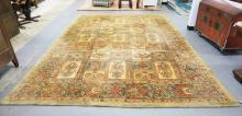 MANCHESTER WOOL RUG IN BROWN AND GREEN TONES WITH STYLIZED FLOWERS. 9 FT 3 IN X 13 FT 2 IN