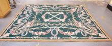 GREEN FLORAL HOOKED RUG. 9 FT 9 IN X 7 FT 11 IN