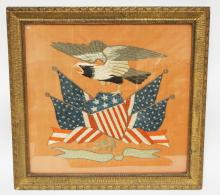 FRAMED EMBROIDERY OF AN EAGLE ABOVE AMERICAN FLAGS AND A STARS & STRIPED DECORATED SHIELD. *E. PLUYRIBUS UNUM* ON A RIBBON BELOW. 19 1/2 X 18 1/2 INCHES.