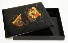 BLACK LACQUERED ASIAN BOX WITH FOLDING FAN DECORATIONS ON THE LID. 11 X 9 1/4 INCHES.