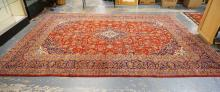 ROOM SIZE ORIENTAL RUG IN RED & BLUE WITH A MEDALLION CENTER. 12 FT 10 INCH X 9 FT 8 INCHES.