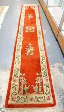ORIENTAL RUG IN RED. 2 FT 3 INCH BY 11 FT 11 INCH RUNNER.