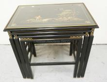 NEST OF BLACK LACQUERED AND PAINT DECORATED ASIAN NESTING TABLES. EACH WITH AN INSET GLASS TOP. THE LARGEST HAS A 24 X 15 3/4 INCH TOP. 23 1/2 INCHES HIGH.