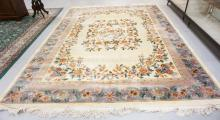 ROOM SIZE CHINESE SCULPTED FLORAL RUG MEASURING 9 FT X 12 FT.