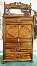 WALNUT VICTORIAN ABATTANT WITH EBONIZED ACCENTS, BANDED AND BURL DRAWER FRONTS, AND MIRROR TOP. 40 IN WIDE, 76 IN H