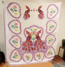 BEDSPREAD W/ PEACOCK AND HEART DESIGN. VERY COLORFUL. APP 8 FT X 7 1/2 FT