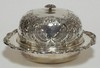 LEGACY, ENGLAND ORNATE SILVER PLATED BUTTER DISH W/ FLOWER FINIAL. 8 3/8 IN DIA, 4 1/2 IN H