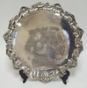 ROUND FOOTED SILVER PLATED TRAY W/ SHELL AND SCROLL BORDER. SIGNED BB W/ A RAMPANT LION IN A CIRCLE. 18 3/4 IN DIA