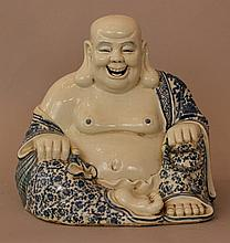 Chinese porcelain smiling Buddha, in sitting possi