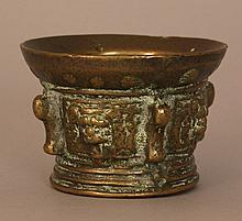 Spanish mortar, bronze casted with four lion head portraits and volutes and