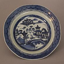 Chinese Porcelain Dish  with blue painted landscape in the center  and orna