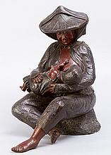 Bronce Sculpture of a Mother with child, casted and hand finsihed with ligh