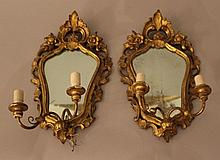 Pair of Rococo style mirros each with two branches for two lights; carved a