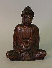 Wooden carved Asian Buddha, the head in resting po