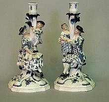 Pair of German porcelain candle sticks with a lady