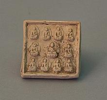 Asian terracotta plate with eleven signs of Buddha