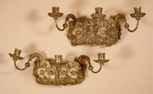 Pair of carved wood and gilt wall sconces