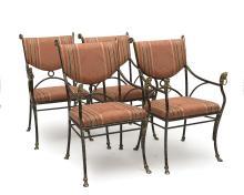 4 chaises en métal à accotoirs à têtes de cheval,, assises et dossiers recouverts de tissu rose, vert et jaune. Pieds sabots.