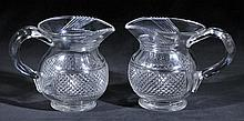 Jugs.  - A pair of Georgian Irish cut glass jugs, circa 1820,