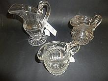 Jugs.  - Three Georgian cut glass jugs,