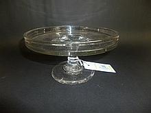 Tazza.  - A Georgian plain glass tazza with dished circular top,