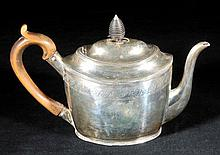 Teapot. A George III silver teapot by Peter, Ann & William Bateman, London 1803