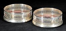 Bottle Coasters. A pair of Elizabeth II silver coasters, by WI Broadway & Co, B