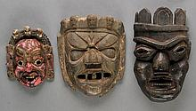 Nepal.  A group of three Nepali wooden masks, including two large examples, var