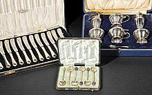 Mixed Silver. A cased silver condiment set by Mappin & Webb, Birmingham 1934,