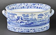 Footbath. A Victorian blue and white twin handle pottery footbath,  printed wit