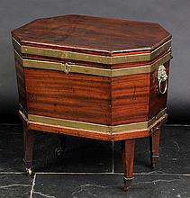 Cellerette. A George III mahogany cellerette,  of octagonal form bound in brass