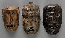 Bhutan.  A  group  of  three Bhutanese wooden masks, including one with the fea