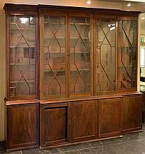 Bookcase. A George III mahogany breakfront bookcase,  with three astragal glaze