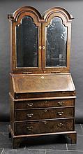 Bureau Bookcase. An 18th-century walnut bureau bookcase,  the twin arched top w