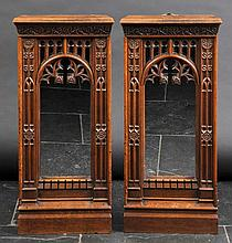 Mirrors. A pair of oak Ecclesiastical mirrors in the Gothic style,  heavily car