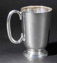 Mug. An Elizabeth II silver mug by Walker & Hall, Sheffield 1958,  of plain for
